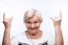 Closeup of elderly woman showing Stock Images