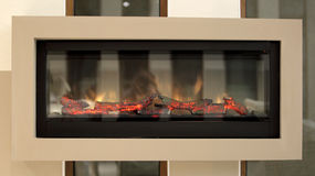 Closeup of electric artificial fireplace Stock Image