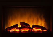 Closeup of electric artificial fireplace orange fire interior Royalty Free Stock Images