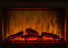 Closeup of electric artificial fireplace orange fire interior Stock Image