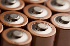 Closeup of electric batteries. Low angle closeup of electric batteries and accumulators AAA AA with selective focus on top Royalty Free Stock Photo