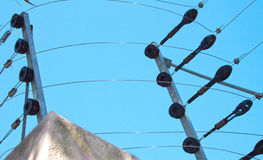 Closeup of Electric Fence Mounted On Boundary Wall Stock Images