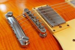 Closeup of electric guitar. Detail, selective focus. Royalty Free Stock Images