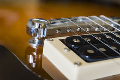 Closeup of electric guitar pickup and strings Royalty Free Stock Image