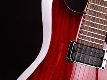 Closeup of electric guitar. Closeup of red electric guitar neck, strings and pickup Royalty Free Stock Photo