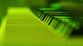 Closeup Electric Piano Keys under Flashes of Colourful Lights. Closeup keys of electric piano under flashes of colourful lights stock footage