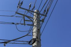 Closeup of electric power pole under blue sky. Closeup of electric power pole under deep blue sky, cloudless. Brazil royalty free stock photo