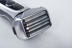 Closeup of Electric Shaver. Against White. Horizontal Image Royalty Free Stock Photos