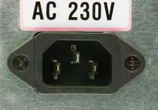 Closeup  of the electrical socket on the back of the computer power supply. AC 230V Royalty Free Stock Images