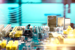 Closeup on electronic board, baclground. Closeup on electronic board in hardware repair shop, blurred and toned image. Shallow DOF, no focal point Stock Images