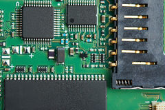 Closeup of electronic board circuit. With digital components and chips stock images