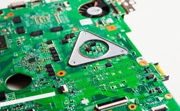 Closeup of electronic circuit board. Extreme Closeup of Microchips Details, green motherboard, selective focus stock photography