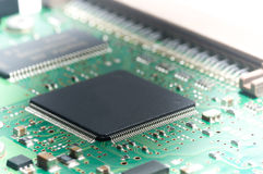 Closeup of electronic circuit board with processor.  Royalty Free Stock Images