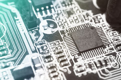 Closeup of electronic circuit board with processor. Background stock image