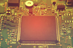 Closeup of electronic circuit board with processor Royalty Free Stock Photography