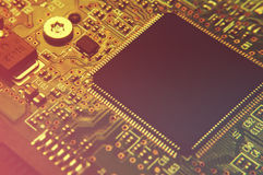 Closeup of electronic circuit board with processor Royalty Free Stock Photo