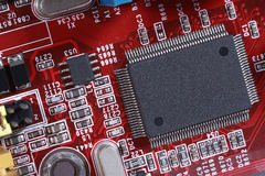 Closeup of electronic circuit red board with processor of compu Royalty Free Stock Photos