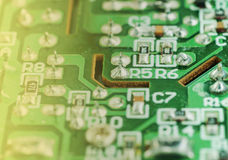 Closeup of an electronic printed circuit board. Closeup of an electronic printed broken circuit board with many electrical Stock Photography