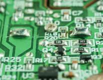 Closeup of an electronic printed circuit board. Closeup of an electronic printed broken circuit board with many electrical Royalty Free Stock Photo