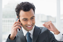 Closeup of elegant businessman using cellphone Royalty Free Stock Images