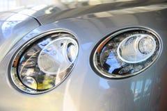 Closeup of elegant headlights car royalty free stock photo