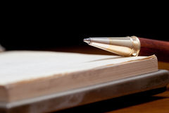 Closeup of an elegant pen on a notebook Royalty Free Stock Images