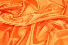 Closeup of elegant shiny orange silk background. Stock Images
