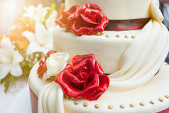 Closeup of elegant wedding cake with edible decoration Stock Images
