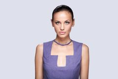 Closeup on elegant woman in fashionable stylish dress posing in studio. Stock Images