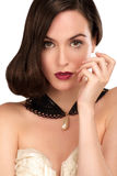 Closeup of an elegant woman with jewel and  brown hair Royalty Free Stock Photos