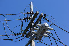 Closeup Eletricity line and electricity post Stock Images