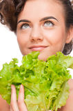 Closeup emotional beauty woman with green lettuce Royalty Free Stock Image