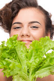 Closeup emotional beauty woman with green lettuce Royalty Free Stock Photography