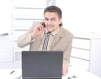 Employee of the company working on laptop in the office. royalty free stock photos