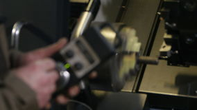 Closeup employee operates equipment with remote control stock video footage