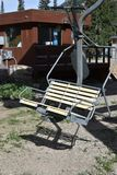 Chairlift in the summertime with ticket booth in background. royalty free stock image