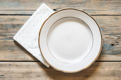 green polka dot towel and empty white plate. Top view with copy royalty free stock photography