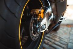 Closeup enduro metal shiny steel brake pads of Fast extreme motorbike Motorcycle bike speed baggy, rimes with yellow sport stripe. Closeup enduro metal shiny royalty free stock photo