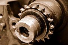 Closeup engine shaft. With gear wheel royalty free stock image