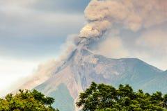 Closeup of erupting Fuego volcano, Guatemala. Smoke billows from erupting Fuego volcano just after dawn near Antigua, Guatemala, Central America royalty free stock image