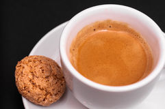 Closeup of an espresso and amarettini Royalty Free Stock Images