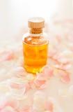 Closeup of essential oil and rose petals Stock Photos