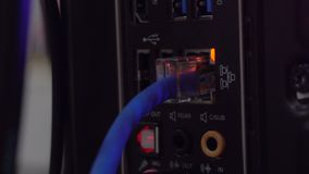 Closeup of ethernet network connection port from server or PC On the back. In dark room stock footage