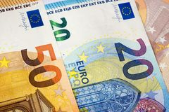 Closeup of 20 and 50 euro banknotes  as money background. Stock Photo