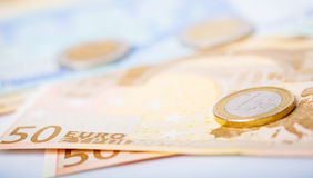 Closeup of euro banknotes and coins Royalty Free Stock Photos