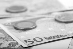 Closeup of euro banknotes and coins Stock Image