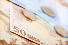 Closeup of euro banknotes and coins Royalty Free Stock Image