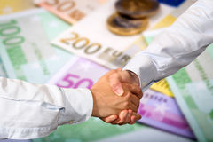Closeup of euro banknotes and coins Royalty Free Stock Photo