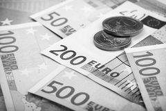 Closeup of euro banknotes and coins Stock Photo