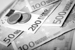 Closeup of euro banknotes and coins Royalty Free Stock Image